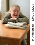 handicapped woman with home... | Shutterstock . vector #1247042227
