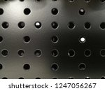 close up of perforated metal... | Shutterstock . vector #1247056267