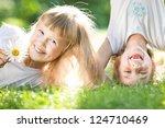 happy children playing outdoors ... | Shutterstock . vector #124710469
