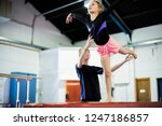 Coach Training Young Gymnast To ...