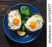 top view healthy avocado toasts ... | Shutterstock . vector #1247228377