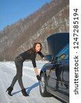 young beautiful girl trying to...   Shutterstock . vector #1247285194