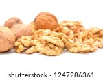 raw walnuts on white background   Shutterstock . vector #1247286361