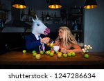 unusual couple at bar counter... | Shutterstock . vector #1247286634