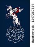 santa riding unicorn and... | Shutterstock .eps vector #1247287534