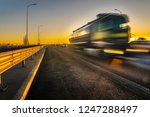 truck on the highway at sunset | Shutterstock . vector #1247288497