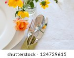table setting with plates ... | Shutterstock . vector #124729615