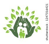 green hands and leafs holding... | Shutterstock .eps vector #1247316421