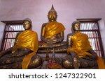 old buddha statue of wat nakhon ... | Shutterstock . vector #1247322901