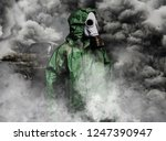 Man In Gas Mask And Cloak For...