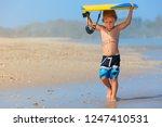 baby boy   little surfer run... | Shutterstock . vector #1247410531