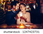 romantic couple dating in pub... | Shutterstock . vector #1247423731