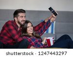 couple fighting for remote... | Shutterstock . vector #1247443297