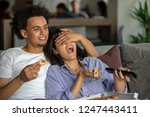 happy couple watching tv while... | Shutterstock . vector #1247443411