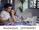young couple watching a movie... | Shutterstock . vector #1247446987