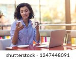 businesswoman using phone while ... | Shutterstock . vector #1247448091
