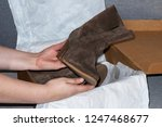 close up. boots in female hands.... | Shutterstock . vector #1247468677