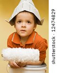 boy with newspaper hat and... | Shutterstock . vector #12474829