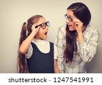 happy surprising mother and... | Shutterstock . vector #1247541991