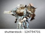 Stock photo five year old boy holding up his large cat 124754731