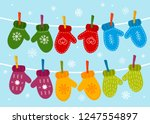 multicolored warm mittens hang... | Shutterstock .eps vector #1247554897