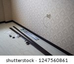 skirting board installation | Shutterstock . vector #1247560861