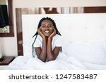 smiling woman waking up in her... | Shutterstock . vector #1247583487