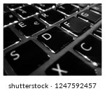black keys on retroiluminated... | Shutterstock . vector #1247592457