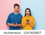 cheerful young couple standing... | Shutterstock . vector #1247603857