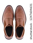men's brown shoes isolated on a ... | Shutterstock . vector #1247604631