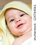 Image of an adorable baby girl covered with a towel - stock photo