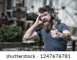 man bearded hipster with... | Shutterstock . vector #1247676781