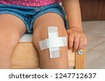 child with adhesive bandage on... | Shutterstock . vector #1247712637