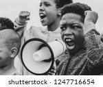 young boy shouting on a... | Shutterstock . vector #1247716654