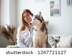 blonde girl playing with her... | Shutterstock . vector #1247721127