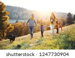 a young family with two small... | Shutterstock . vector #1247730904