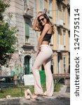 young girl brunette posing in... | Shutterstock . vector #1247755114