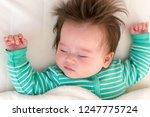 sleepy little baby boy taking a ... | Shutterstock . vector #1247775724