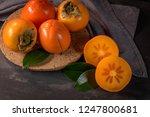 ripe persimmon fruits in a cork ... | Shutterstock . vector #1247800681