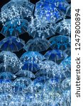 the beauty of white umbrellas... | Shutterstock . vector #1247800894