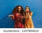 female friends blowing off... | Shutterstock . vector #1247804614
