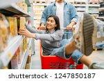man carries woman in the cart ... | Shutterstock . vector #1247850187