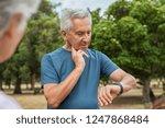 senior tired man checking pulse ...   Shutterstock . vector #1247868484