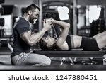 personal trainer helping woman... | Shutterstock . vector #1247880451
