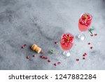 pomegranate champagne mimosa... | Shutterstock . vector #1247882284