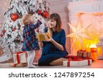 child with mom with gifts near... | Shutterstock . vector #1247897254