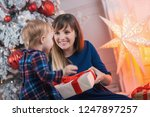 child with mom with gifts near... | Shutterstock . vector #1247897257