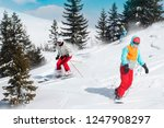 skiers and snowboarders riding...   Shutterstock . vector #1247908297