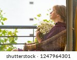 woman with chamomiles sitting... | Shutterstock . vector #1247964301