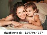 happy woman with her daughter... | Shutterstock . vector #1247964337